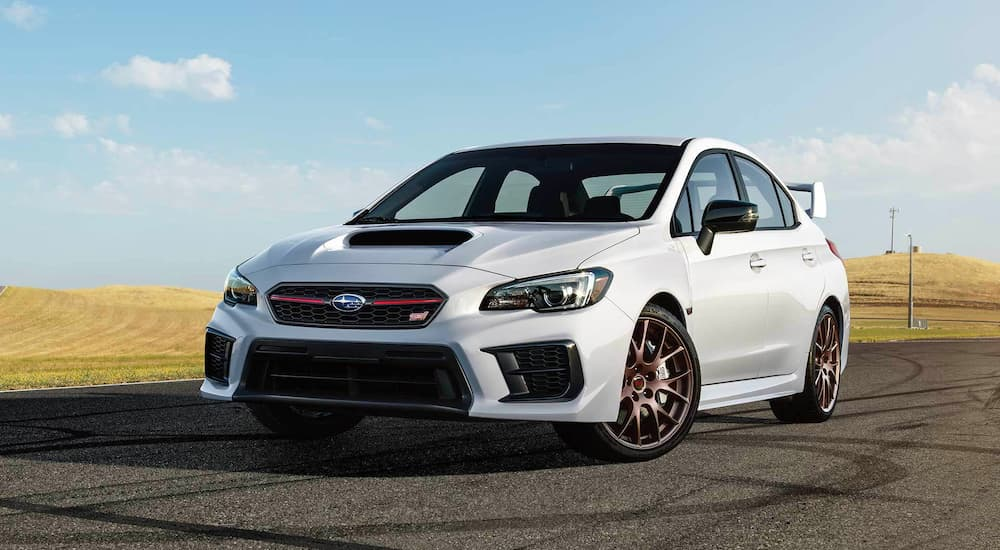 A white 2020 Subaru WRX STI Series.White is shown from the front parked in an empty lot.
