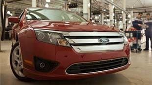 Front view of a red Ford Fusion parked in the service department at Bowen Scarff Ford in Kent near Seattle