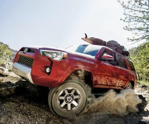 A red 2019 Toyota 4Runner offroading