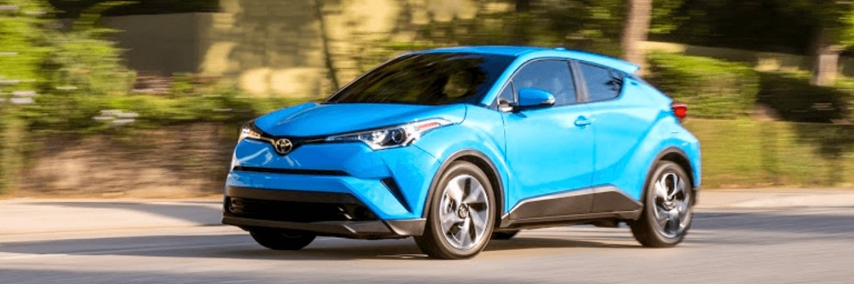 Blue driving Toyota C-HR