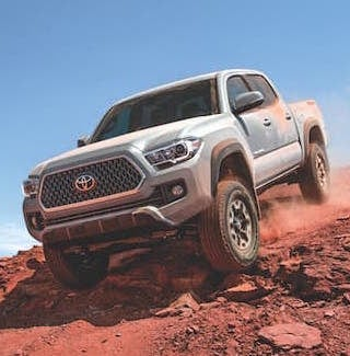 A silver 2019 Toyota Tacoma offroading