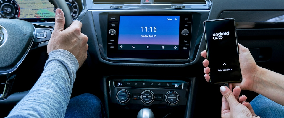 A person connecting their android phone to their 2019 VW Tiguan