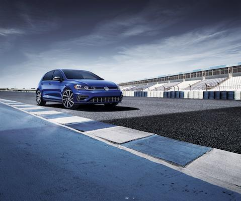 A blue 2019 Volkswagen Golf on a track
