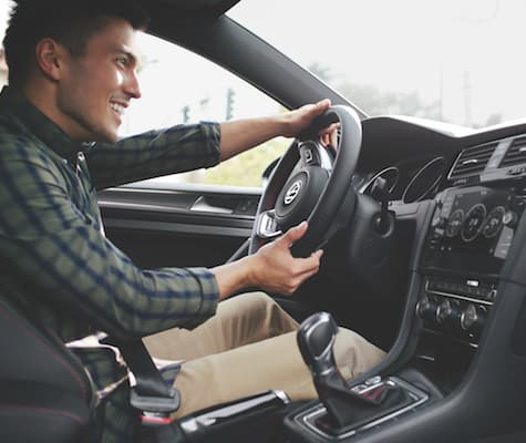 A man driving the 2019 Volkswagen Golf GTI