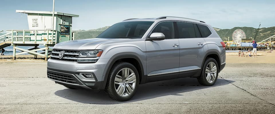 A silver 2019 Volkswagen Atlas parked by the beach