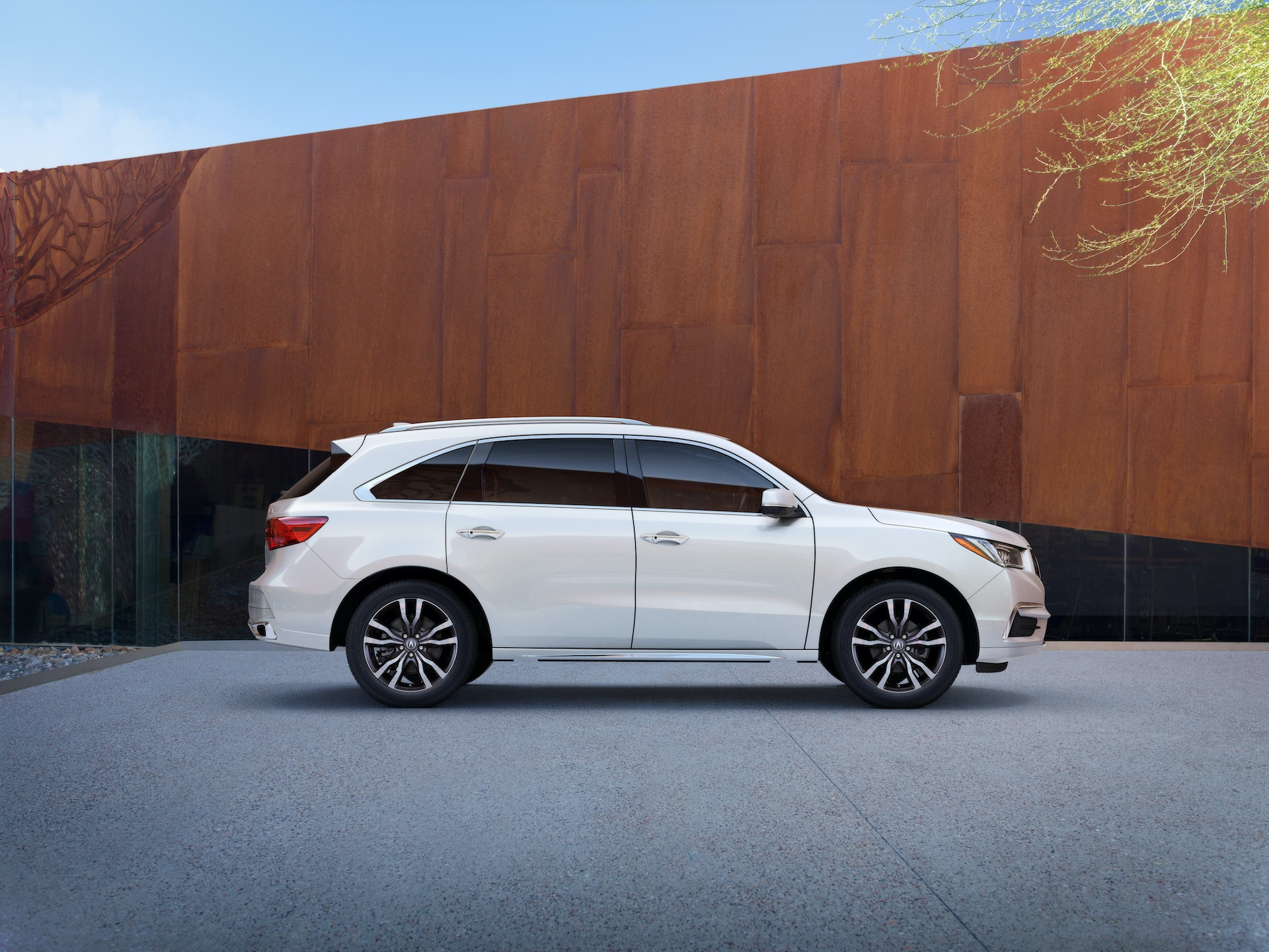 Comparison of the 2020 Acura MDX & 2020 Toyota Highlander at Acura Hunt Valley | Profile view of White 2020 Acura MDX parked by wooden wall