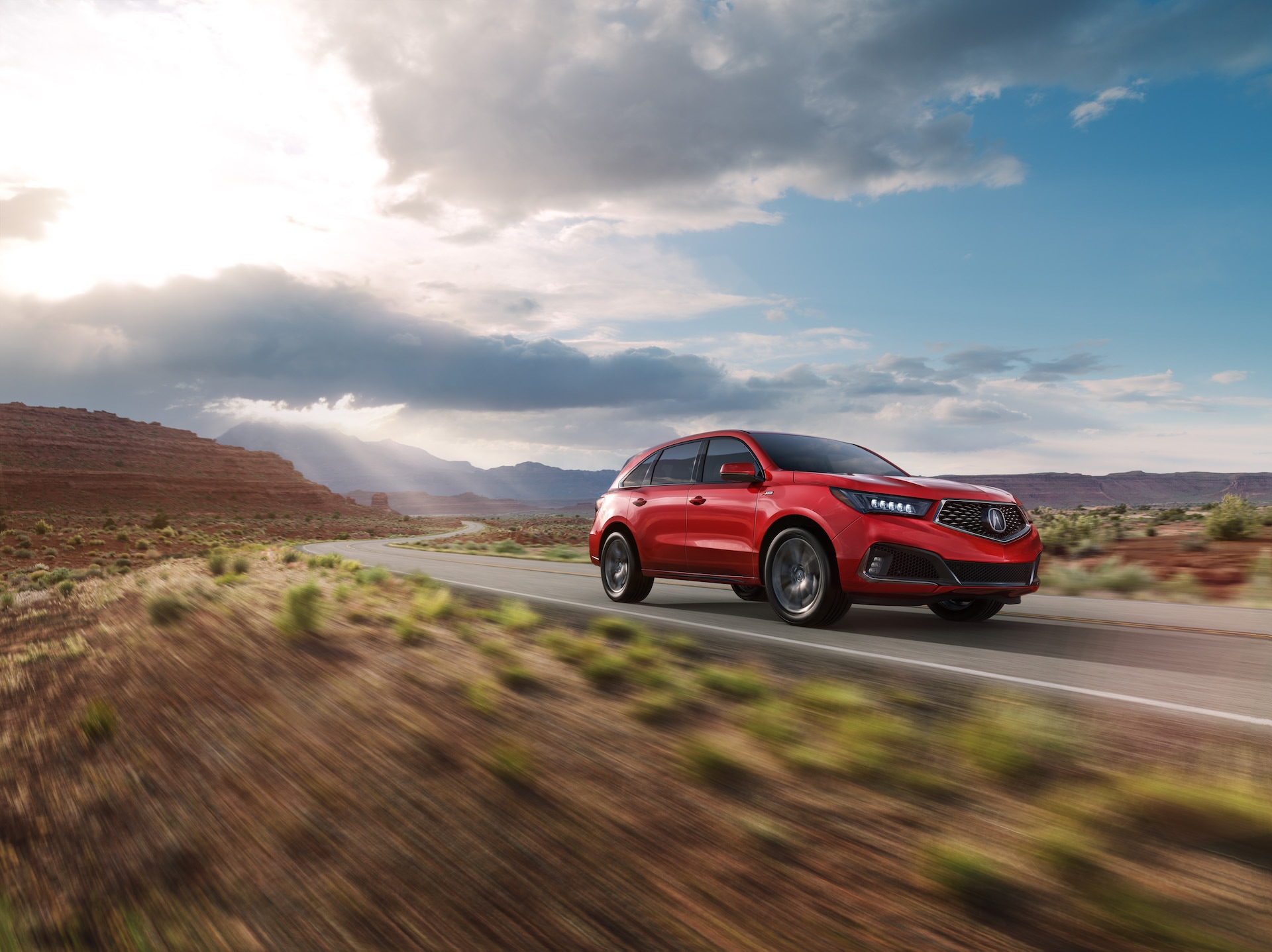 Compare the 2020 Lexus RX & the 2020 Acura MDX at Acura Hunt Valley | Red 2020 Acura MDX driving on desert road