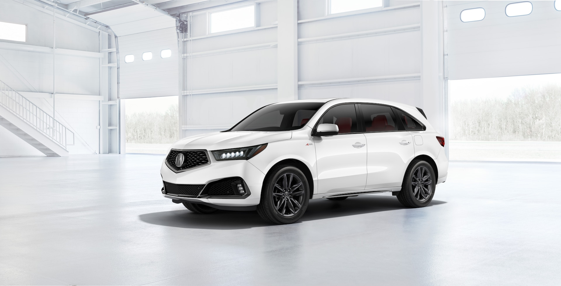 Compare the 2020 Lexus RX & the 2020 Acura MDX at Acura Hunt Valley | White 2020 Acrua MDX parked in garage