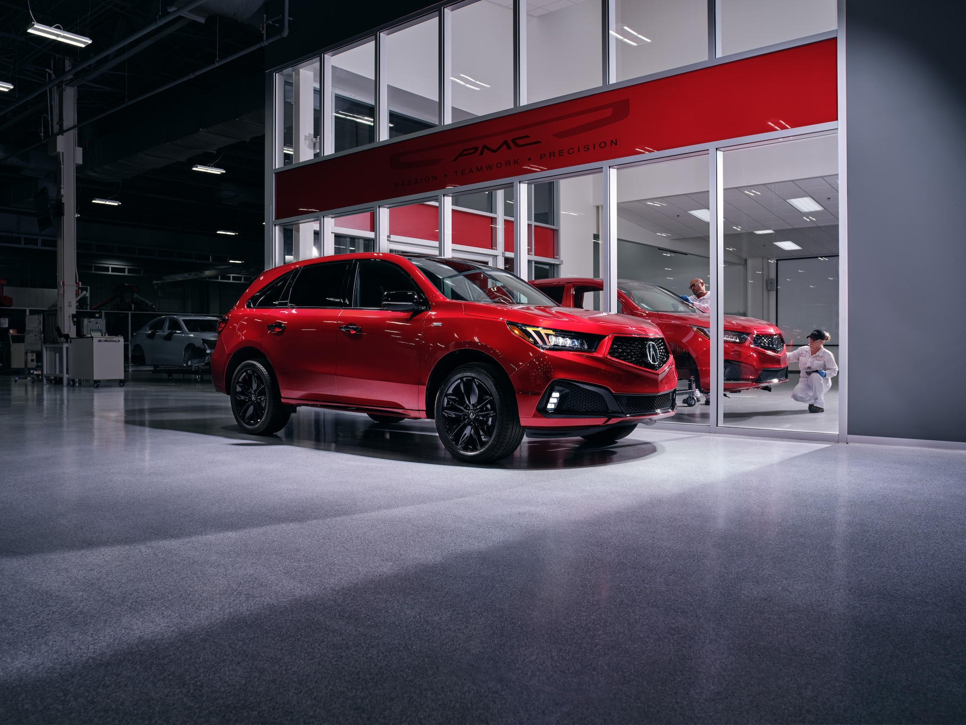 Comparison of the 2020 Acura MDX & 2020 Toyota Highlander at Acura Hunt Valley | Red 2020 Acrua MDX parked in garage