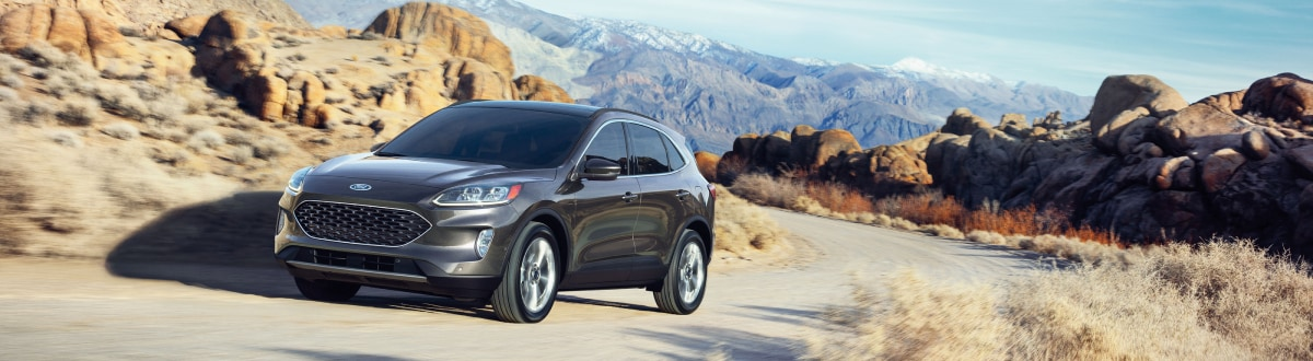New Ford Escape driving through rocky hills