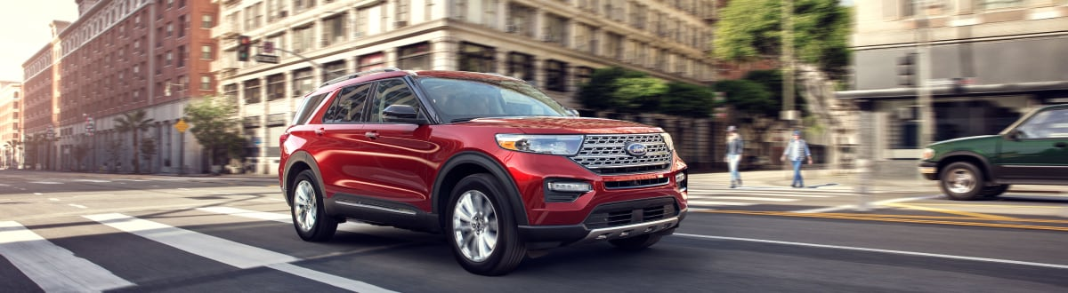 New Ford Explorer driving through the city
