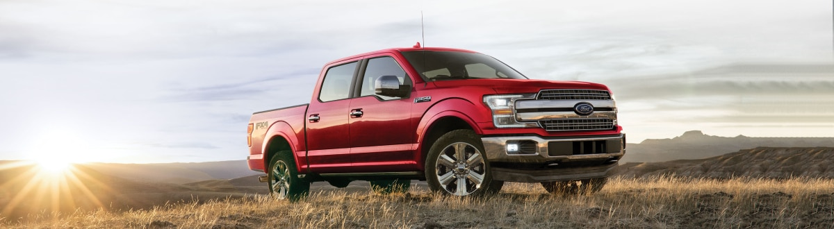 New Ford F-150 in a field at sunrise