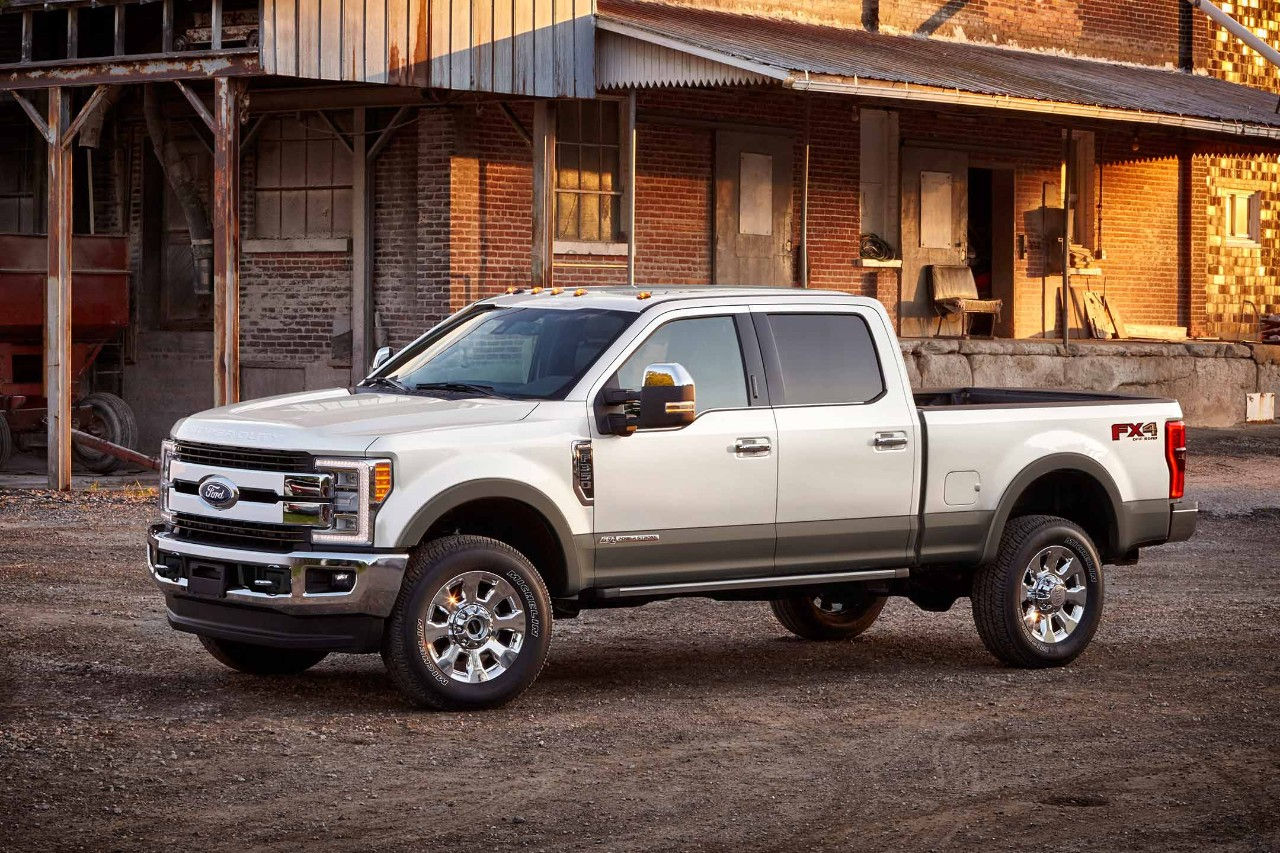 New White 2018 Ford F350 Pickup Truck Parked in front of Old Factory Building