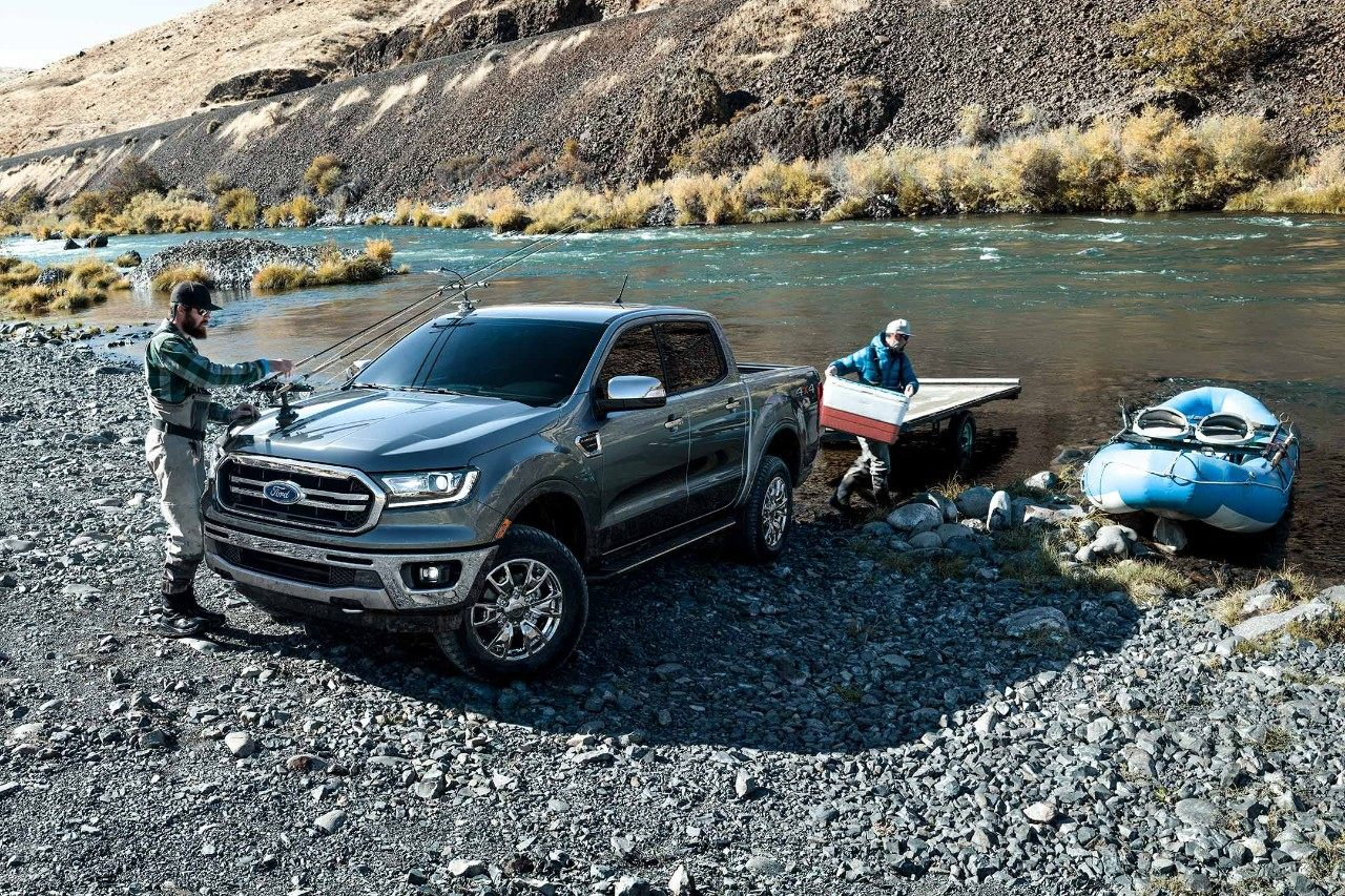 New Gray 2019 Ford Ranger Parked Next to a lake with a Trailer and a Boat