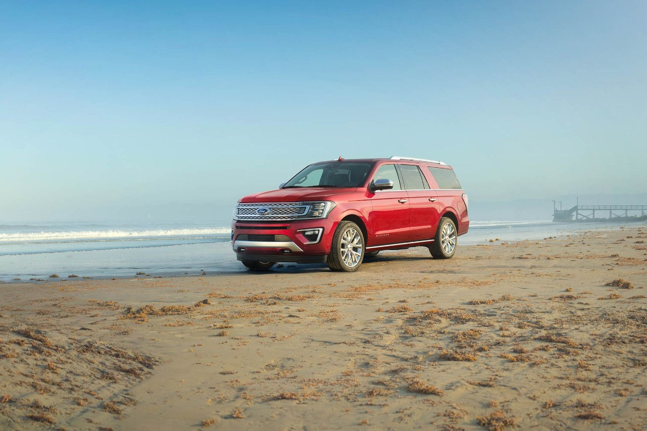 New Burgundy Ford Expedition SUV Parked On a Sandy Beach