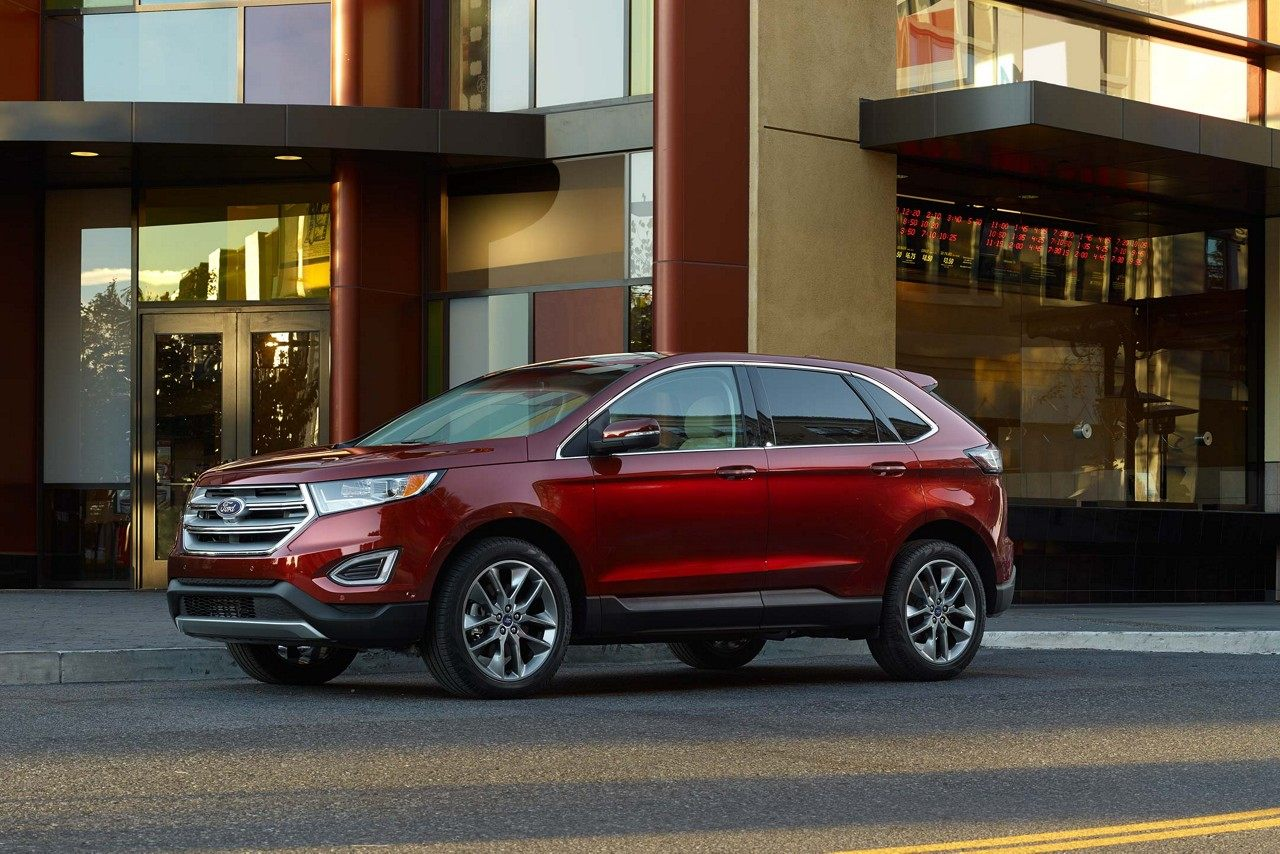 New Burgundy  Ford Edge Suv Parked At The Curb In Front Of A Building