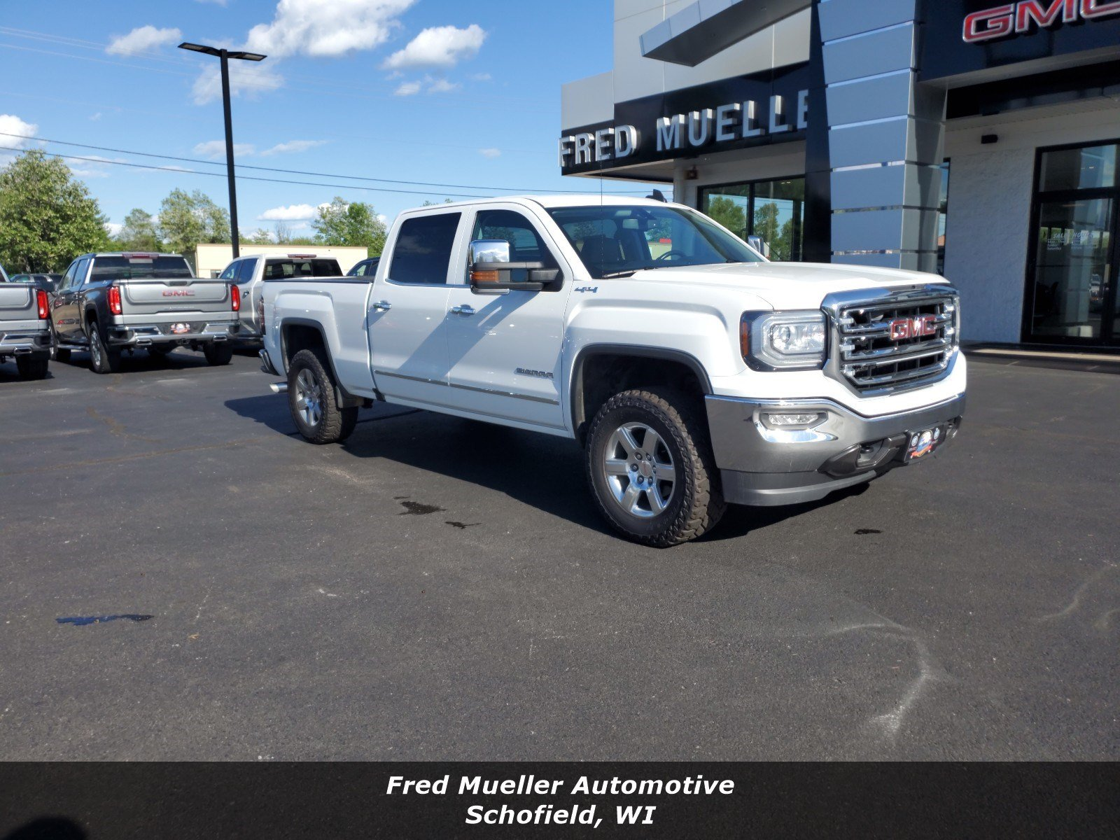 Featured pre-owned vehicles 2016 GMC Sierra 1500 SLT Truck Crew Cab for sale near you in Schofield, WI