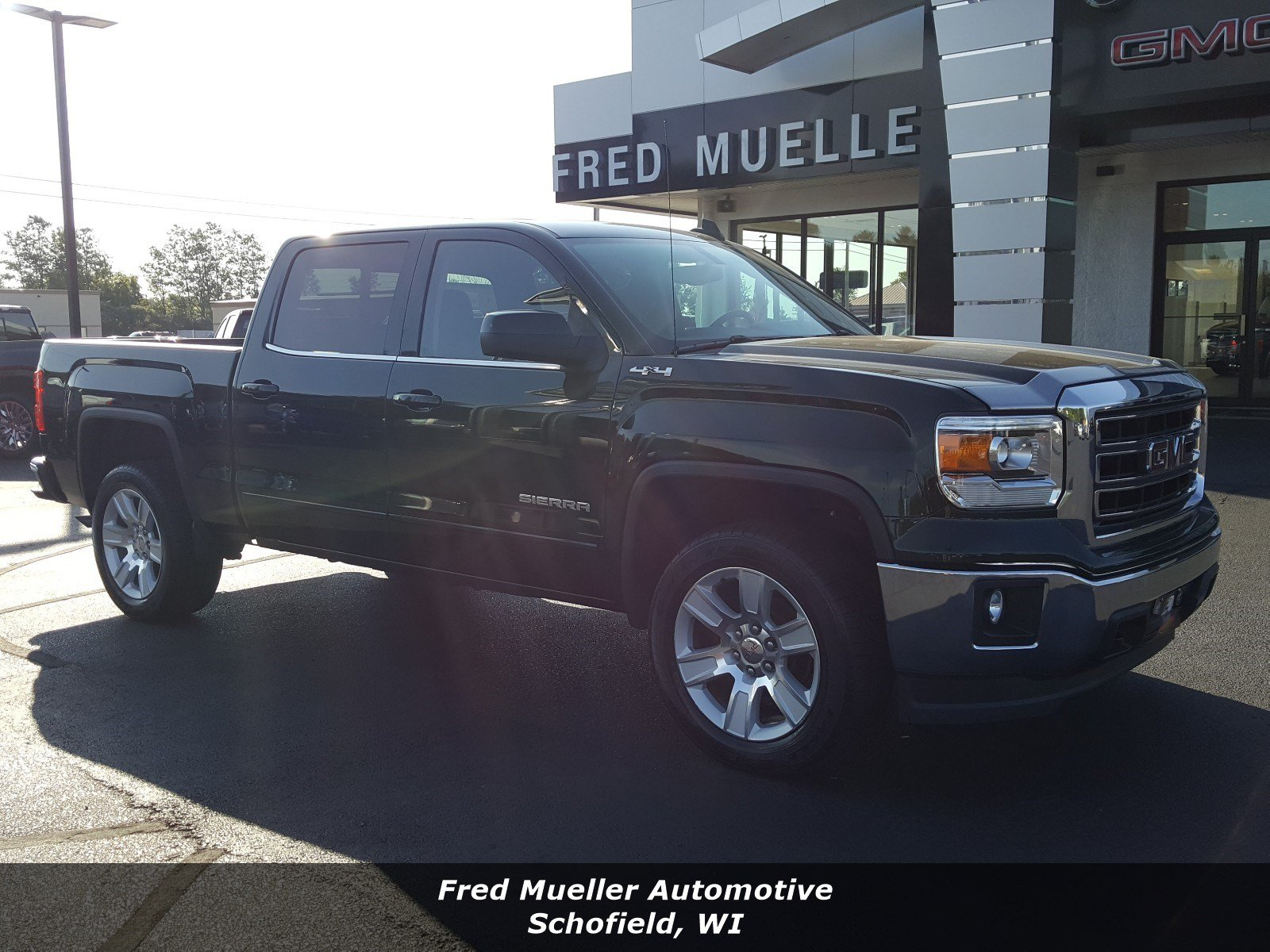 Featured pre-owned vehicles 2015 GMC Sierra 1500 SLE Value Package Truck Crew Cab for sale near you in Schofield, WI