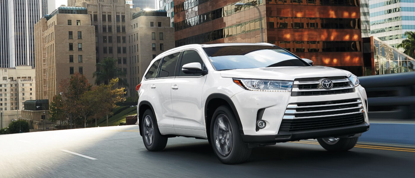 2019 Toyota Highlander driving on city bridge