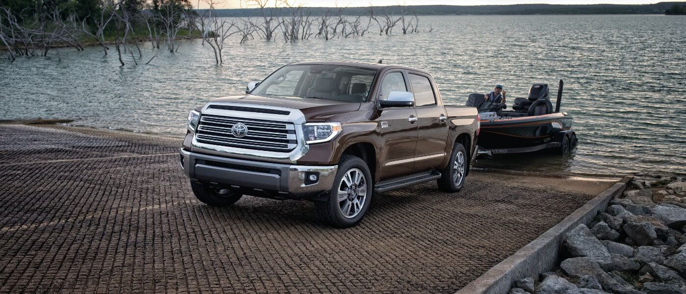 2020 Brown Toyota Tundra Towing a Fishing Boat