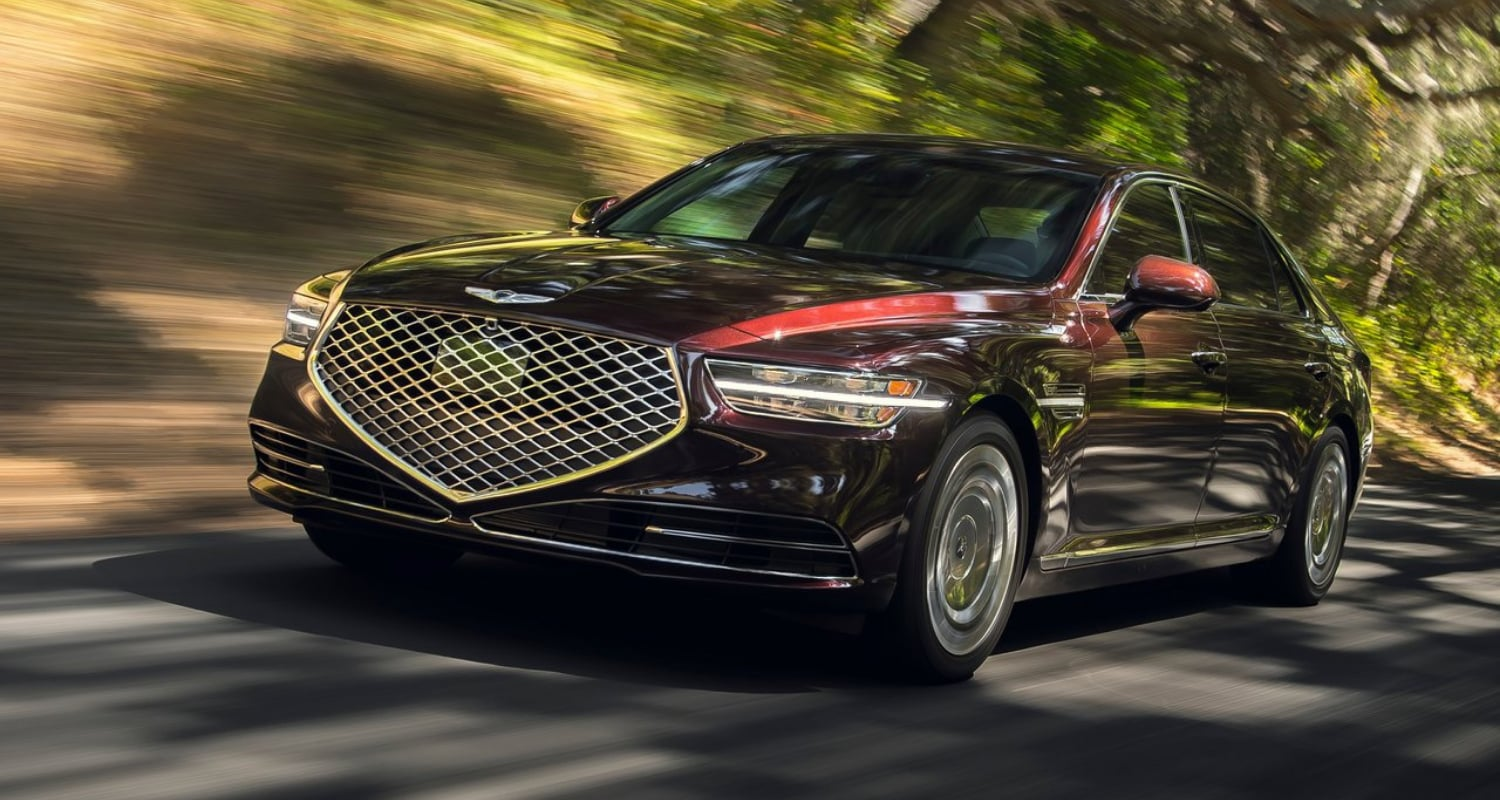 New 2021 Genesis G90 Sedan Exterior driving down the open road
