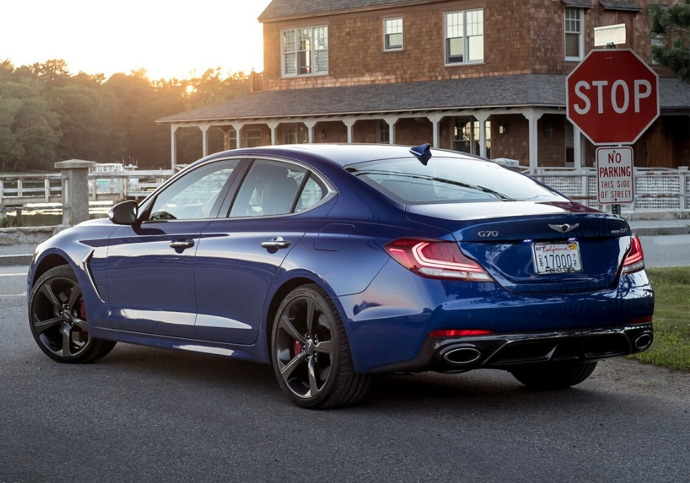 2020 Genesis G70 luxury sedan rear exterior view coming to a stop sign at an intersection
