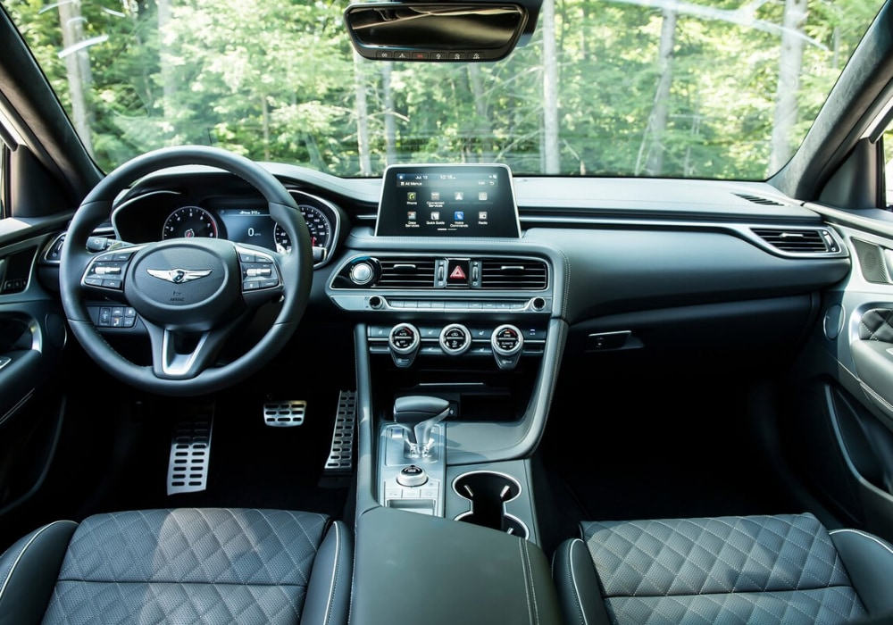 Interior design view of the 2020 Genesis G70 luxury sedan showing quilted leather seats and innovative interior technology