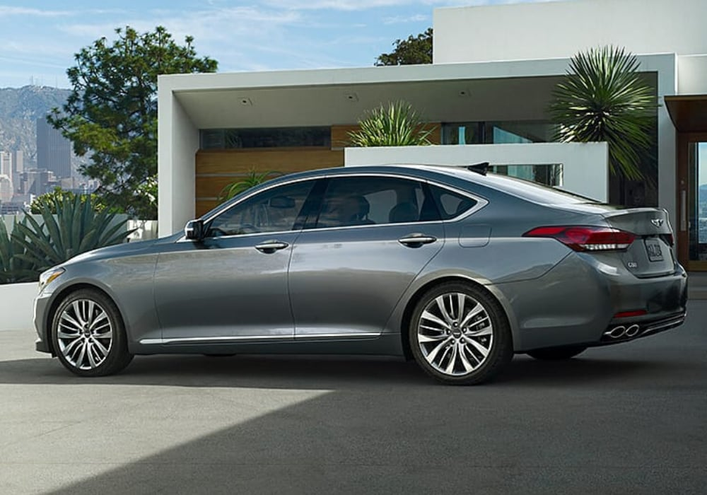 2020 Genesis G80 exterior driver side view seen in Savile Silver