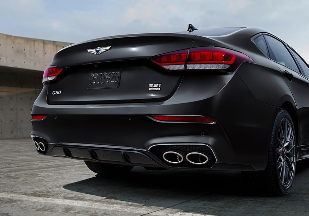 2020 Genesis G80 3.3T Sport rear exterior showing dual exhaust tips and the 3.3T Sport emblem