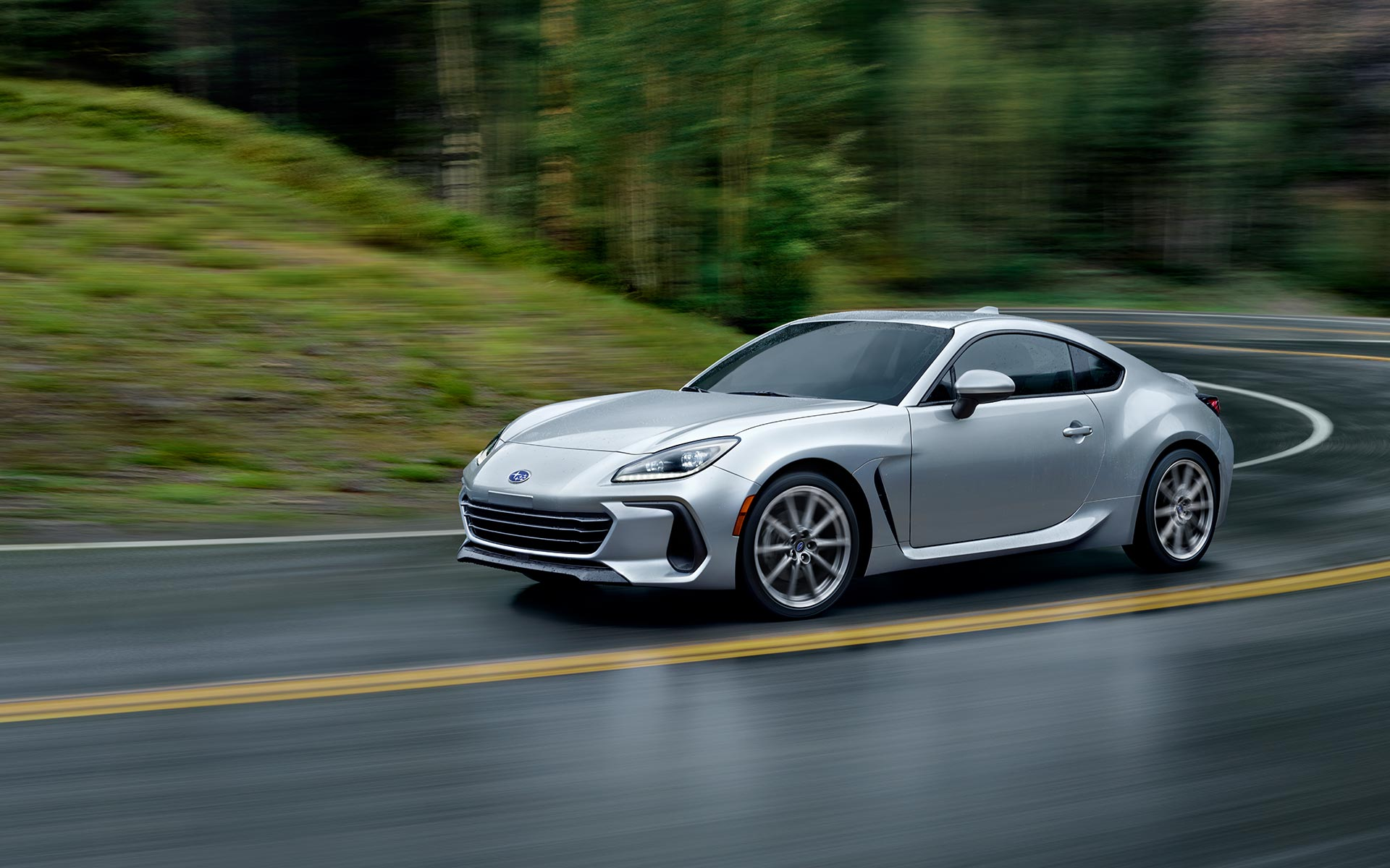 2022 Subaru BRZ driving on a wet road