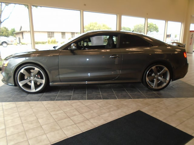 Featured pre-owned 2014 Audi RS 5 coupe quattro S tronic AWD Sports Coupe 4.2L Quattro AWD Sports Coupe for sale in Sioux Falls, SD