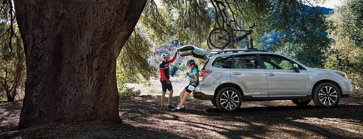 2018 Subaru Forester parked next to a tree