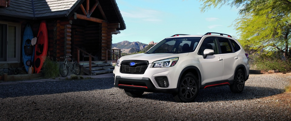2019 Subaru Forester parked outside of a cabin