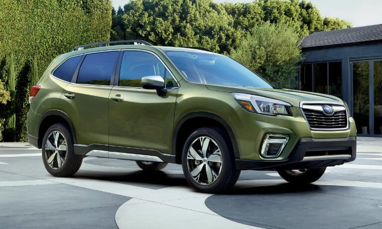 Green 2020 Subaru Forester parked in a drive way