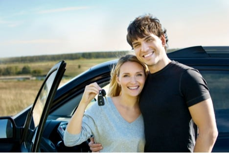 couple holding keys to new car