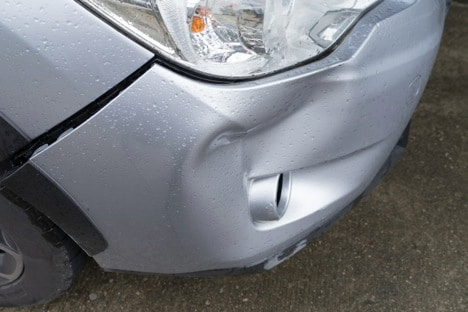 car with dented bumper