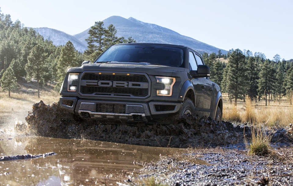 A 2018 Ford F-150 Raptor driving towards the viewer