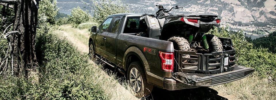2019 Ford F-150 with ATV in woods