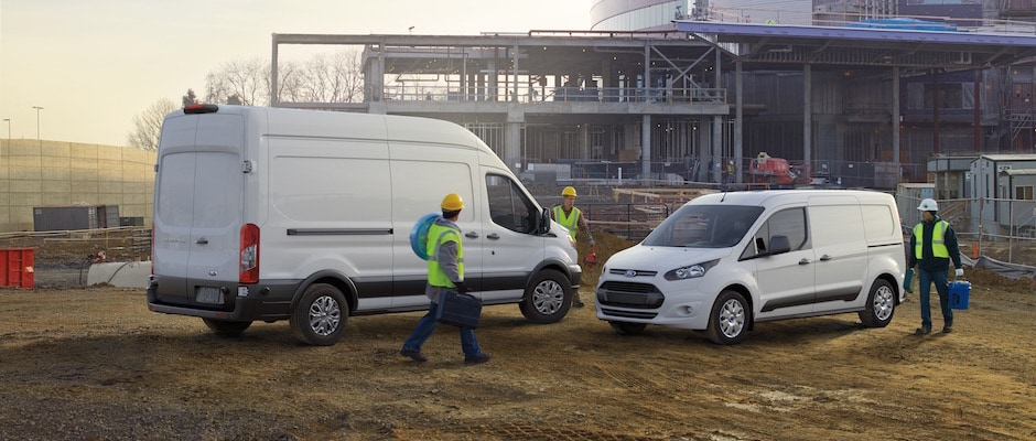 Two Ford Transits at a construction site
