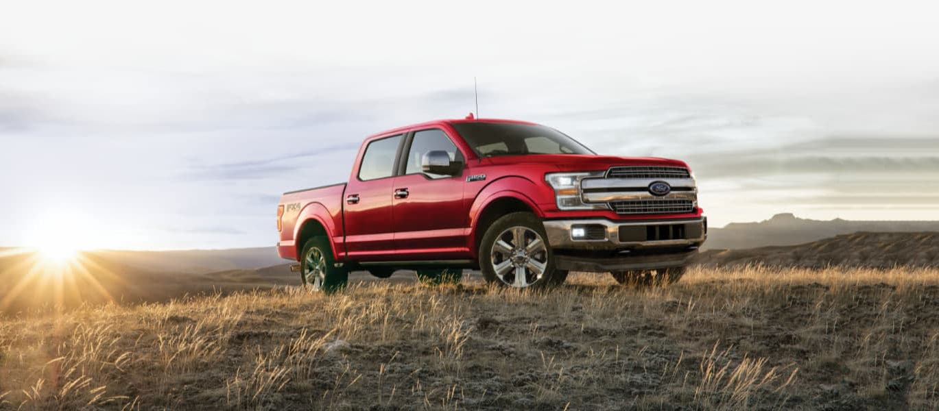 A red 2020 Ford F-150 parked on a hill