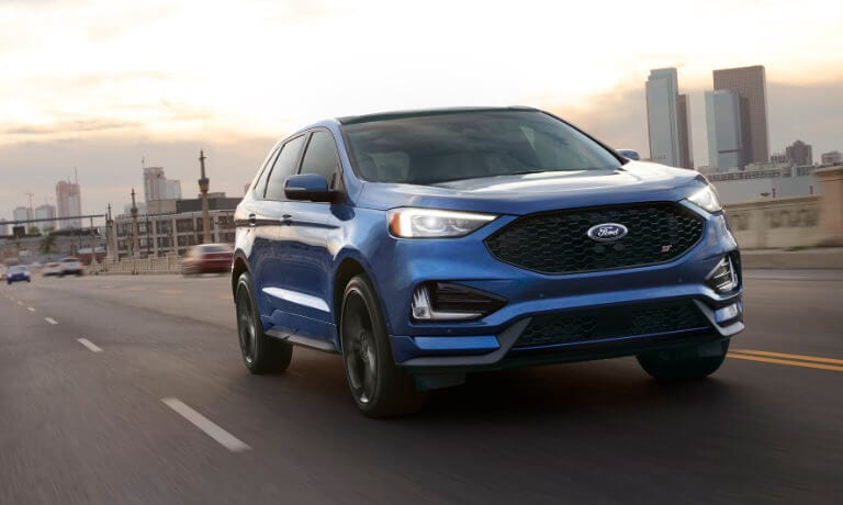 Blue 2019 Ford Edge on road