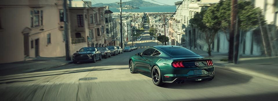 2019 Ford Mustang driving down street