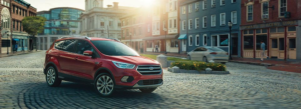 Red Ford Escape Parked In Street