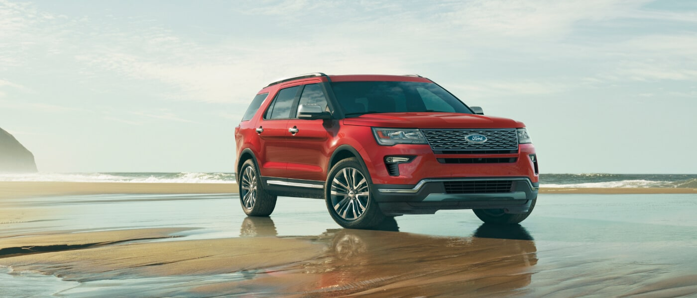 Red 2019 Ford Explorer on beach