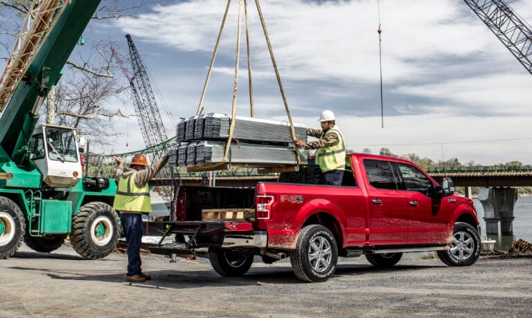 A red 2019 Ford F-150 on construction site