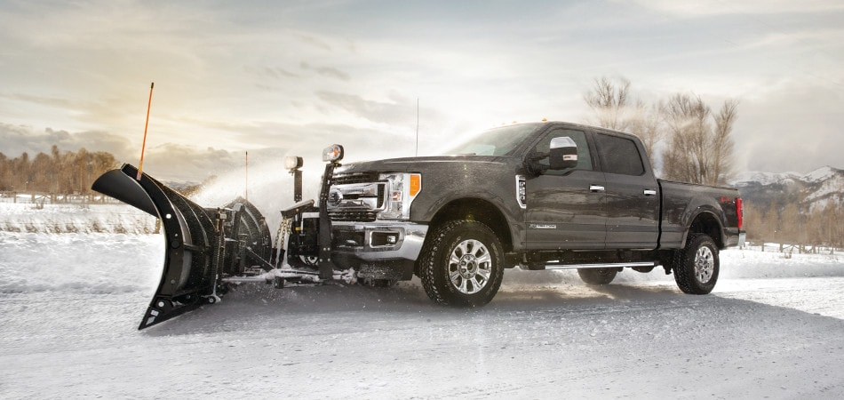 A Ford F-250 plowing snow