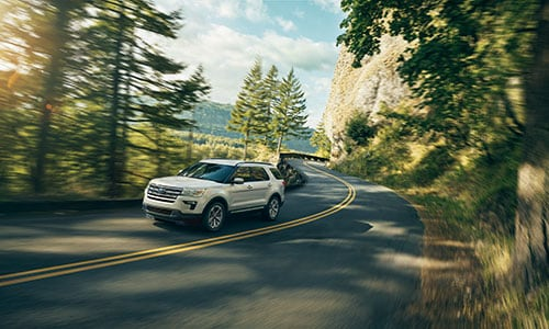 2019 Ford Explorer driving down road in forest