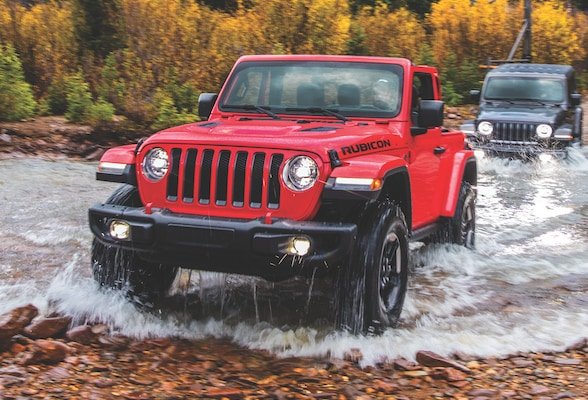 Jeep Wrangler off roading through river
