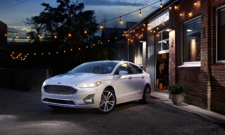 2020 Ford Fusion parked outside a garage under string lights