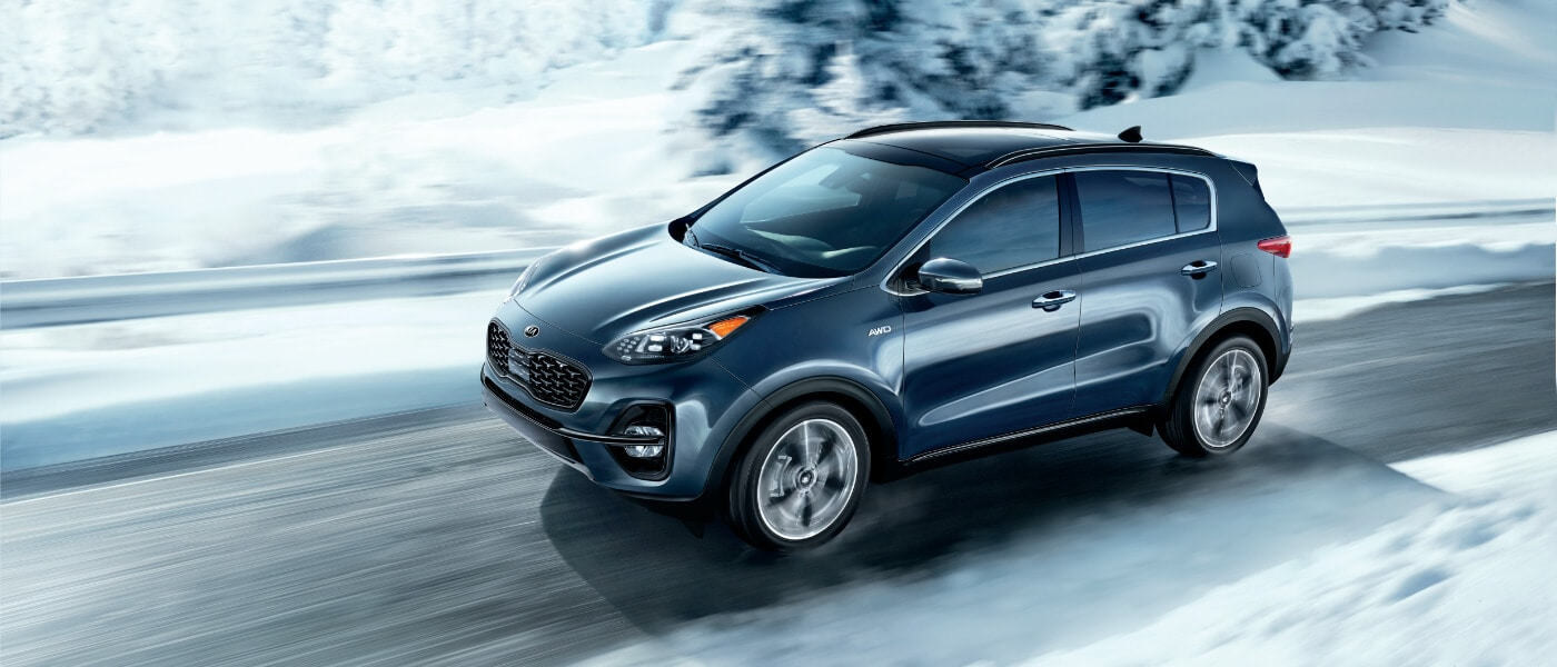 2020 Kia Sportage Exterior in Blue Driving On A Snowy Road